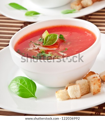 delicious cold Gazpacho soup in white bowl - stock photo