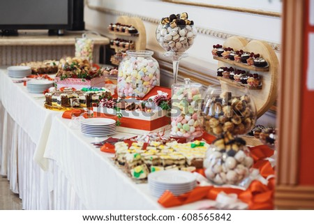 delicious colorful cookies and cakes on the wedding candy bar