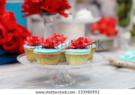 Delicious colorful wedding cupcakes - stock photo