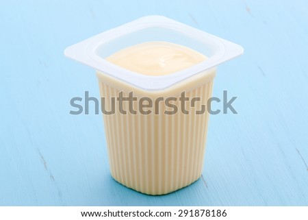 Delicious commercial french custard-style yogurt with all the fruit mixed inside during the process. On vintage retro styling. - stock photo
