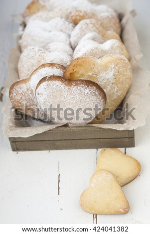 Delicious cookies with hearts to Valentine's Day on a white wooden background - stock photo