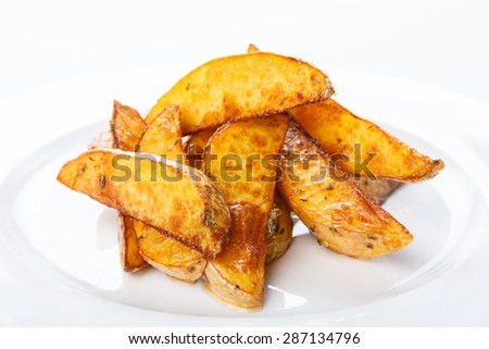 Delicious crispy baked potato wedges closeup - stock photo