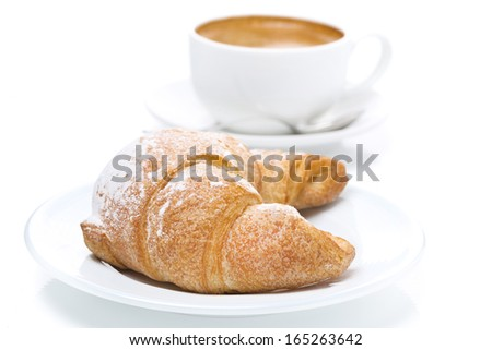 delicious croissant and cup of black coffee, close-up, isolated