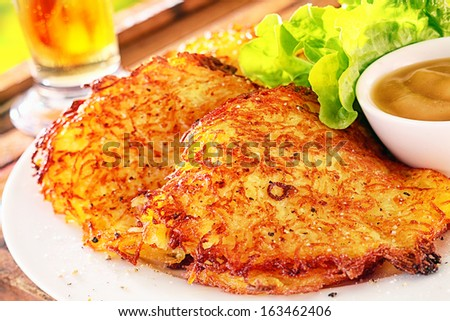 Delicious crunchy potato fritters or pancakes made from grated potatoes deep fried until golden and crisp