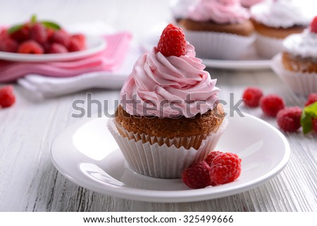 Delicious cupcake with berries on table close up - stock photo