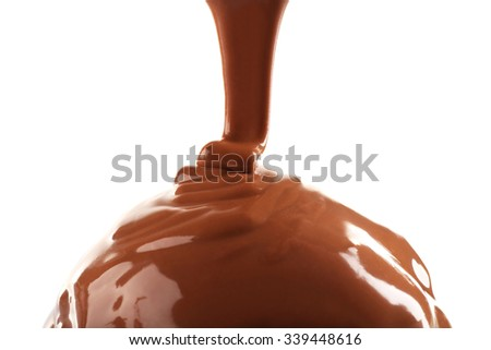 Delicious cupcake with melted chocolate topping, isolated on white, close-up - stock photo
