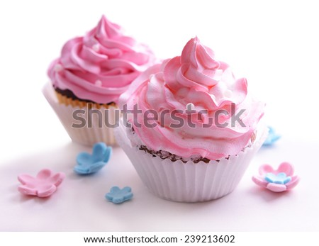 Delicious cupcakes isolated on white - stock photo