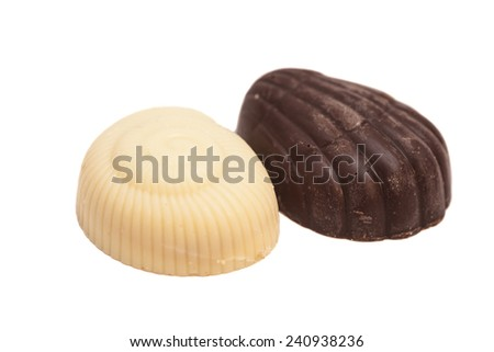 Delicious dark and milk chocolate isolated on white - stock photo