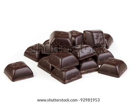 Delicious dark chocolate pralines isolated on white - stock photo