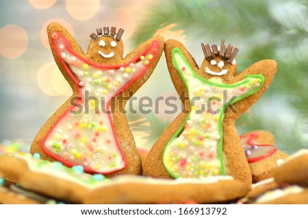 Delicious decorated Christmas cookies on bokeh background - stock photo