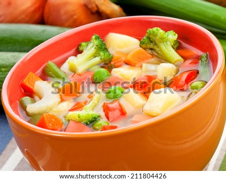 Delicious diet vegetarian soup on the table - stock photo