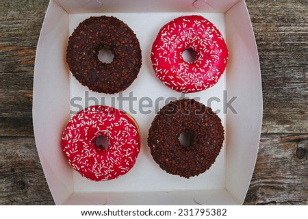 Delicious donuts on the table - stock photo