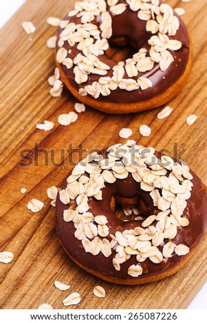 Delicious donuts on the wooden board - stock photo