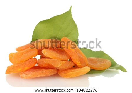 delicious dried apricots with  green leaves isolated on white - stock photo
