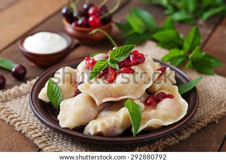 Delicious dumplings with cherries and jam - stock photo