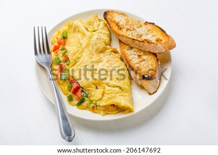 Delicious Egg Omelette with Vegetables on the Plate - stock photo