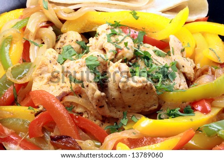 Delicious fajitas made with organic chicken and other fine ingredients - stock photo