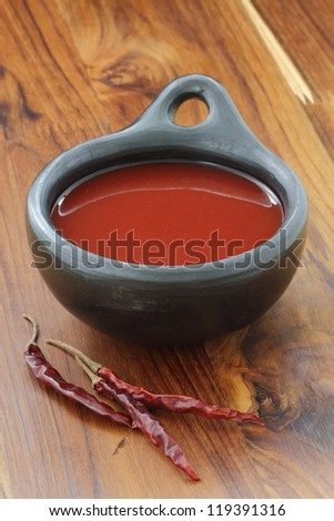 Delicious fermented hot chili sauce, made with red hot peppers, garlic and unrefined sea salt. Simple to make. - stock photo