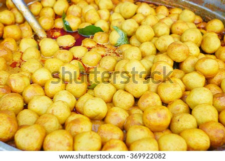 Delicious fish ball curry on bowl at street market display. Fish ball curry is among famous food in Sabah Malaysian Asian streets night market. - stock photo