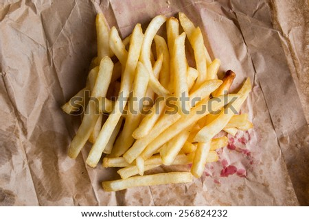 Delicious french fries on it brown paper bag