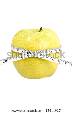 delicious fresh apple with a measuring tape wrapped around it. concept: weight loss, diet - stock photo