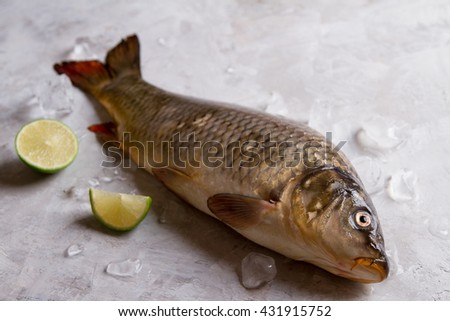 Delicious fresh fish (carp) on  vintage background for healthy food, diet or cooking concept, selective focus