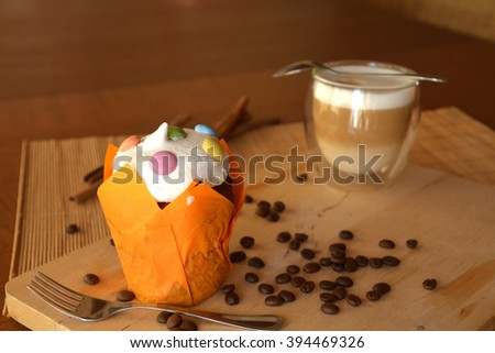 Delicious Fresh Homemade Muffin With Coffee Cup On A Wooden Table.