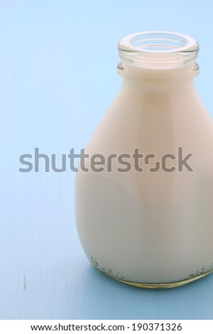 Delicious fresh  milk, on vintage styling. - stock photo
