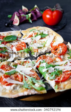 Delicious fresh pizza on dark - stock photo