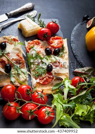 Delicious fresh pizza on dark - stock photo