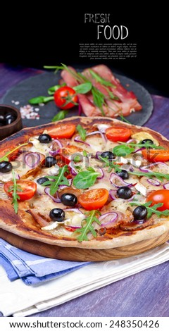 Delicious fresh pizza served on wooden table - stock photo