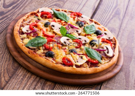 Delicious fresh pizza with seafood. Seafood Italian Pizza slice on wood table horizontal - stock photo