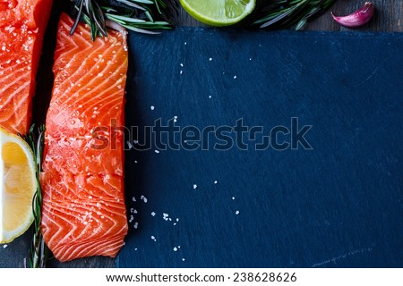 Delicious fresh salmon fillet with herbs and spices. Copy space. Healthy food or diet. Top view - stock photo