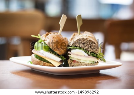 Delicious fresh sandwich waiting for its hungry owner in a welcoming coffee shop - stock photo