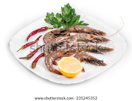 Delicious fresh shrimps with lemon on the white plate Isolated. - stock photo