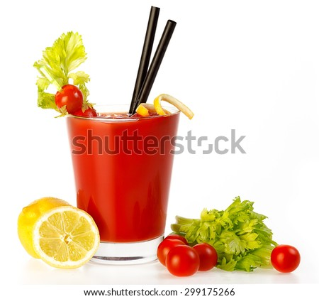 Delicious fresh tomato cocktail made with freshly squeezed tomato, lemon and parsley served in a glass with a celery stick, isolated on white with copy space - stock photo
