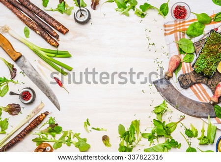 Delicious fresh vegetables, spices and seasoning for tasty cooking with kitchen knife on white wooden background, top view, frame. Healthy  clean or vegetarian food concept. - stock photo