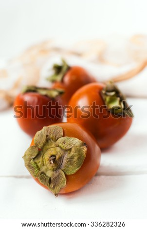 Delicious fresh washed persimmons. Winter fruits. Selective focus. - stock photo