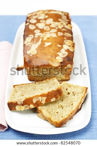 Delicious freshly baked loaf of banana bread with almonds - stock photo