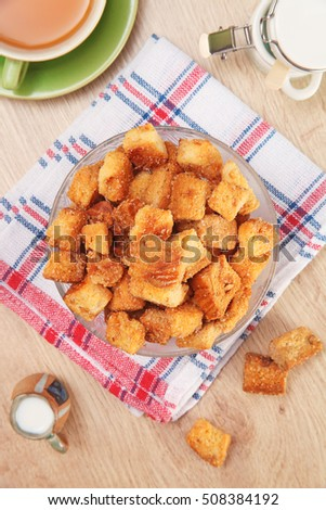 Delicious fried croutons in glass bowl