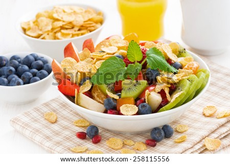 delicious fruit and berry salad for breakfast, close-up, horizontal - stock photo