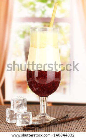 Delicious fruit smoothie on window background