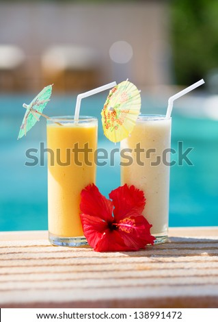 Delicious fruit smoothies on a tropical resort - stock photo