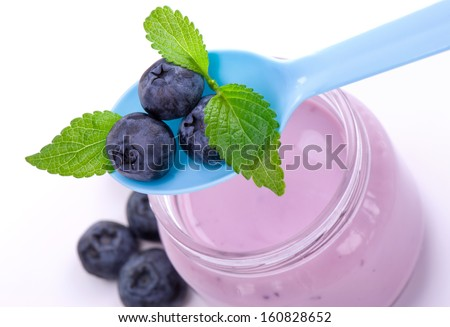 Delicious fruit yougurt with blueberries and mint - stock photo
