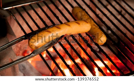 Delicious german sausages on the barbecue grill - stock photo