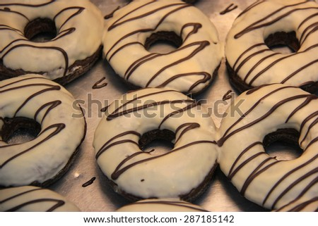 Delicious Glazed Chocolate Donuts  - stock photo