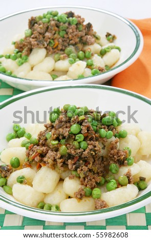 Delicious gnocchi with meat and peas