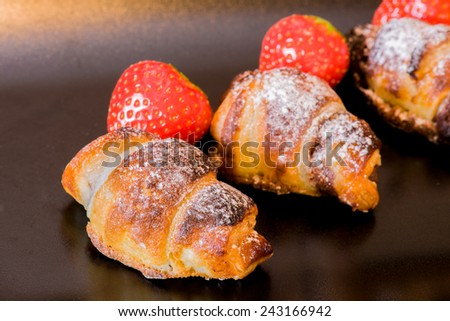 delicious golden croissants filled with strawberries and chocolate  cream - stock photo