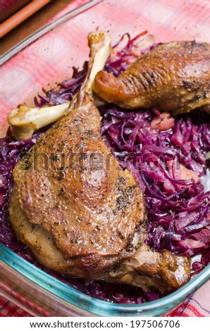 Delicious goose legs baked on red cabbage - stock photo