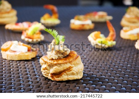 Delicious gourmet plate with texture and color. shrimp sea food canapes. - stock photo